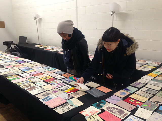 Women researching the Woman's Building archives at Metabolic Studios